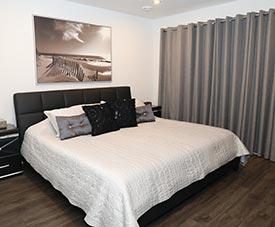 Chambre à coucher d'un condo dans le projet Pointe Est